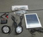 Aurinkopaneeli 10 W ja Led-valaisin järjestelmä sekä muuntaja
