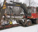 Kaivinkone Lokomo M133, paalutuspuomilla vm. 1985